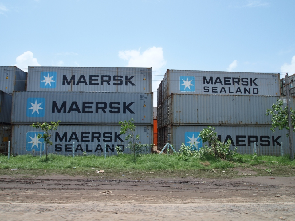 containers stacked outside adani's mundra port.
