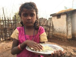 More on malnourishment in Krishnagiri, Tamil Nadu. A girl eats a meagre diet of thin lentil gruel and rice.