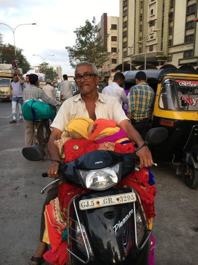 A garment wholesaler returns home after buying stock at Surat, Gujarat (https://scroll.in/article/841882/in-surats-textile-hub-small-businesses-are-afraid-of-gst-but-big-companies-are-not)