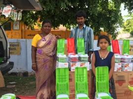 A family that became travelling salesmen. Near Hosur, Tamil Nadu.