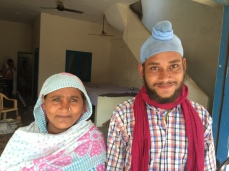 A young man at Amritsar mandi poses with his mother for a photo. https://scroll.in/roving/1214/these-workers-at-amritsars-grain-market-are-smiling-only-for-the-camera